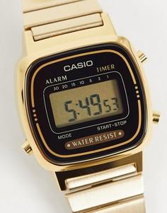 Электронные часы с черным циферблатом и золотистым ремешком Casio Mini LA670WEGA-1EF-Золотой