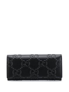 Gucci кошелек с тисненым логотипом GG