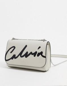Светло-бежевая сумка через плечо с логотипомCalvin Klein-Светло-бежевый