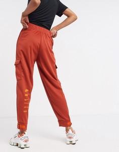 Джоггеры рыжего цвета с логотипом-галочкой и карманами Nike-Оранжевый
