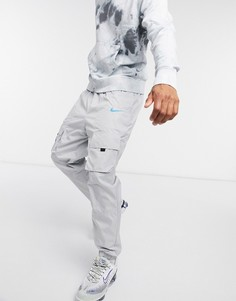 Серые джоггеры с манжетами Nike Air-Серый