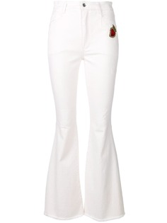 Dolce & Gabbana расклешенные джинсы с заплаткой Sacred Heart