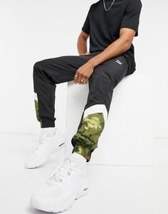 Черные спортивные штаны с логотипомPumaClassicsMCS-Черный