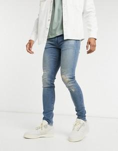 Суженные книзу джинсы в винтажном стиле Levis-Синий