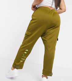 Джоггеры цвета хаки с логотипом-галочкой Nike Plus-Зеленый