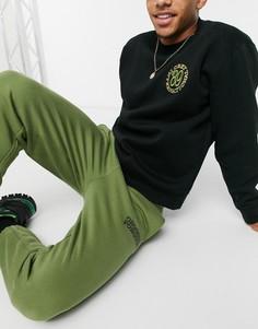 Джоггеры цветахакис логотипомCrooked Tongues-Зеленый