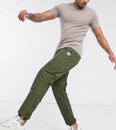 Блестящие джоггеры цвета хаки Ellesse эксклюзивно для ASOS-Зеленый