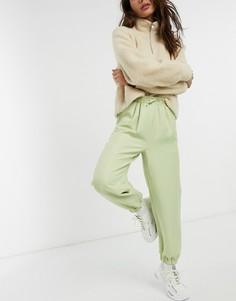 Спортивные брюки в стиле oversized светло-зеленого цвета от костюма ASOS DESIGN-Зеленый