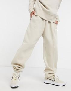 Бежевые джоггеры в стиле oversized с маленьким логотипом-галочкой Nike-Кремовый
