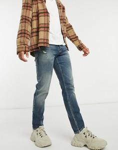 Темно-голубые эластичные джинсы узкого кроя с эффектом винтажной японской потертости ASOS DESIGN-Голубой