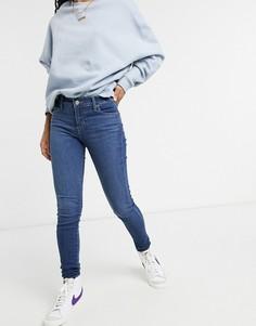 Светло-синие выбеленные супероблегающие джинсы Levis 710-Синий