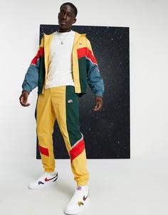 Джоггеры горчичного цвета с манжетами от костюма 19 Nike Heritage Essentials Windrunner-Желтый