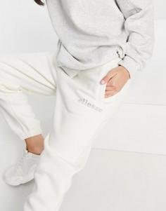 Серовато-белые джоггеры с выложенным стразами логотипом ellesse – эксклюзивно для ASOS-Белый