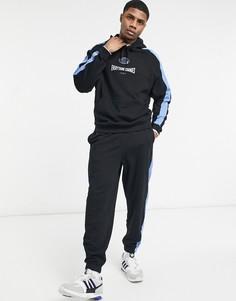 Свободный спортивный костюм черно-синего цвета со вставками по бокам и принтом на груди ASOS DESIGN-Черный цвет