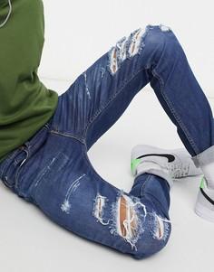Узкие, суженные книзу темно-выбеленные джинсы со рваной отделкой и потертостями Levis Youth 512-Голубой