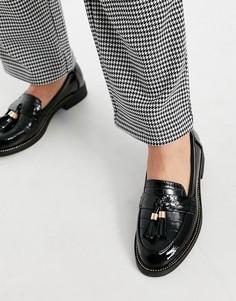 Черные лоферы с эффектом крокодиловой кожи и кисточками schuh Lailah-Черный цвет