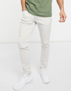 Белые суженные книзу узкие джинсы Levis 512-Светло-бежевый