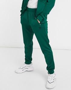 Темно-зеленые узкие джоггеры с логотипом-трилистником adidas Originals essentials-Зеленый цвет