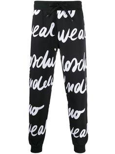 Moschino спортивные брюки с принтом