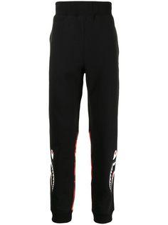 A BATHING APE® спортивные брюки с камуфляжным принтом Bape
