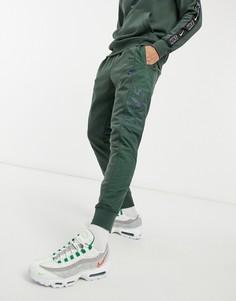 Джоггеры цвета хаки с манжетами Nike Hybrid-Зеленый цвет
