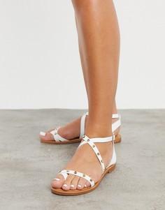 Белые сандалии на плоской подошве с заклепками ALDO-Белый