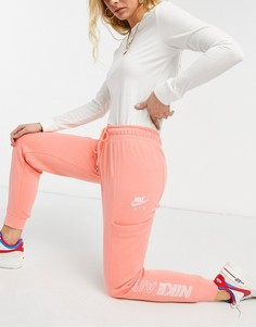 Флисовые джоггеры персикового цвета Nike Air-Оранжевый цвет