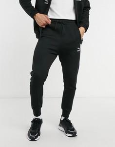 Черные спортивные брюки с логотипом PUMA International-Черный цвет