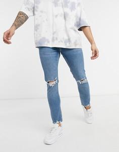 Сине-голубые выбеленные супероблегающие джинсы с рваной отделкой Bershka-Голубой