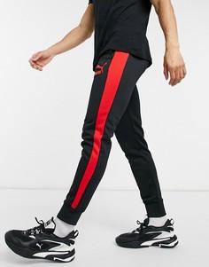 Черные спортивные штаны слоготипом PUMA T7-Черный цвет
