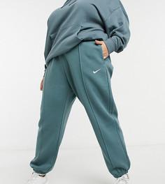 Темно-синие джоггеры в стиле oversized смаленьким логотипом-галочкой Nike Plus-Темно-синий