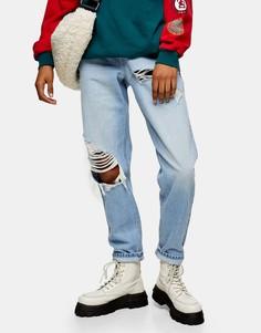 Голубые выбеленные суженные книзу джинсы в винтажном стиле сорваной отделкой Topshop-Голубой