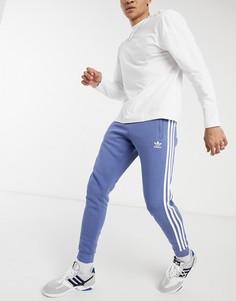 Синие джоггеры с тремя полосками adidas Originals adicolor-Голубой