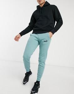 Зеленые спортивные штаны слоготипом Puma Essentials-Зеленый цвет