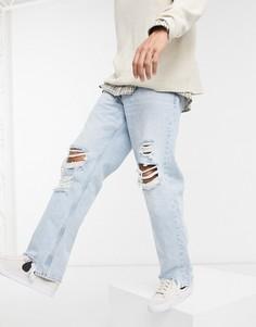 Светло-голубые джинсы в стиле 90-х сорваной отделкой Bershka-Голубой