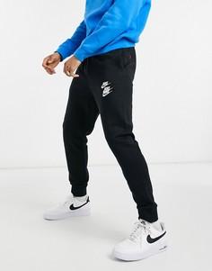Джоггеры черного цвета с манжетами Nike World Tour Pack-Черный цвет