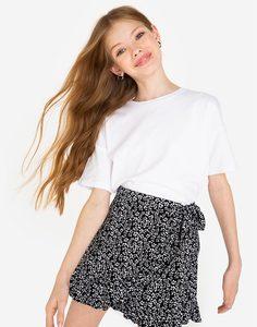 Чёрная юбка-шорты с цветочным принтом и оборками для девочки Gloria Jeans