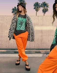 Оранжевые джоггеры в стиле oversized с защипами ASOS DESIGN-Оранжевый цвет