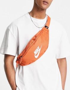 Сумка на пояс бледно-оранжевого цвета Nike Heritage-Оранжевый цвет