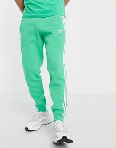 Зеленые джоггеры с тремя полосками adidas Originals adicolor-Зеленый цвет