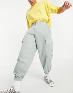 Суженные книзу брюки в стиле oversized с карманами-карго ASOS DESIGN-Зеленый цвет