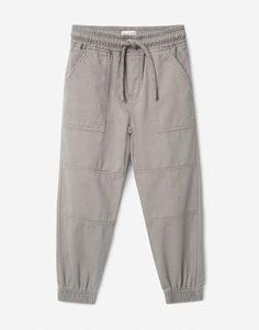Серые брюки-джоггеры с накладными карманами для мальчика Gloria Jeans