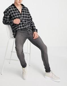Черные выбеленные джинсы суженного книзу кроя Levis-Черный цвет