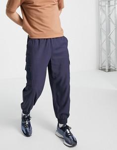 Темно-синие суженные книзу oversized-брюки с карманами карго из материала с добавлением льна ASOS DESIGN-Темно-синий