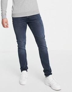 Суженные книзу джинсы зауженного кроя темно-синего цвета с эффектом окрашивания Levis-Темно-синий