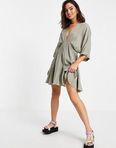 Платье мини цвета хаки с расклешенной юбкой-годе и V-образным вырезом спереди и сзади ASOS DESIGN-Зеленый цвет