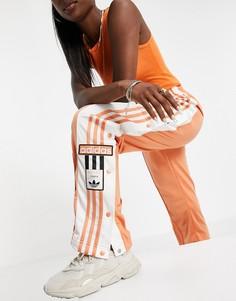 Спортивные штаны приглушенного медного цвета с логотипом сбоку adidas Originals adicolor-Оранжевый цвет