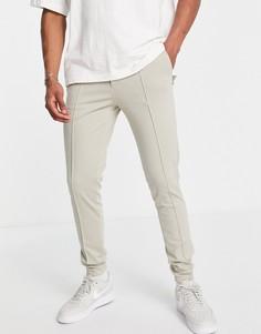 Строгие трикотажные зауженные брюки светло-бежевого цвета с манжетами ASOS DESIGN-Светло-бежевый цвет