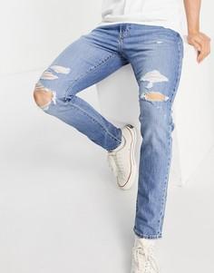 Голубые суженные книзу джинсы с разрывами Levis 512-Голубой