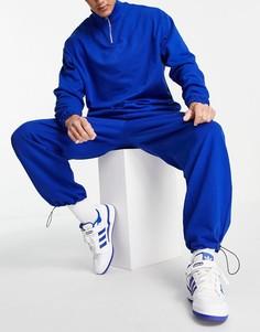 Синий спортивный костюм со свитшотом на короткой молнии и джоггерами в стиле super oversized с застежками-тогл по нижнему краю ASOS DESIGN-Голубой